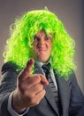 Green hair funny young office worker plays the fool Royalty Free Stock Images