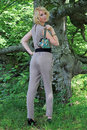 The green handbag a young pretty woman in trousers suit with Stock Photo