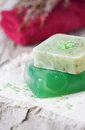 Green handmade soap and red towel salt Stock Image