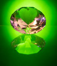Green heart diamond a large glass on a background with reflection which has one large blank facet on it suitable for placing text Royalty Free Stock Photography