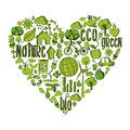 Green heart with environmental icons trendy hand drawn in this illustration is layered for easy manipulation and custom coloring Stock Images