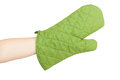 Green heat protective mitten on a female hand isolated white background Royalty Free Stock Images