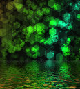 Green hexagon bokeh background reflected in water surface Royalty Free Stock Photos