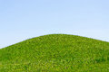 Green hill and sky Royalty Free Stock Photo