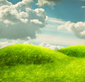 Green hills and a blue sky Stock Image