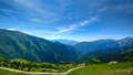 Green hills and blue sky with clouds in china Stock Photos