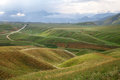 Green hills highland mountain landscape kyrgyzstan central asi asia summer time Royalty Free Stock Image
