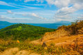 Green hills, sand, water and the mountain on the horizon. Luzon Island. Philippines Royalty Free Stock Photo