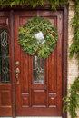 Green holiday christmas wreath on a door Royalty Free Stock Images