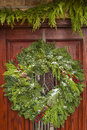 Green holiday christmas wreath on a door Stock Photography