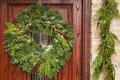 Green holiday christmas wreath on a door Royalty Free Stock Image