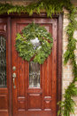 Green holiday christmas wreath on a door Stock Photo