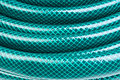 Green hose for watering Royalty Free Stock Photo