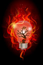 Green house effect concept wildfire inside the light bulb Royalty Free Stock Photos