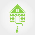 Green house with socket, home electricity icon Royalty Free Stock Photo