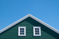 Green house and white roof with blue sky Royalty Free Stock Photo