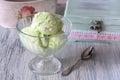 Green ice cream in a glass vase. Pistachio ice cream. Royalty Free Stock Photo