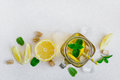Green ice tea with lemon and mint in a glass jar. Top view with Royalty Free Stock Photo