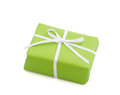 Green isolated giftbox tied with white ribbon for christmas birthday or valentine s day Royalty Free Stock Photos