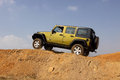 Green jeep wrangler unlimited on x course bafokeng – may scaling tilt bridge obstacle at new track opening event may at bafokeng Stock Photo