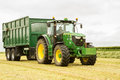 A green John Deere tractor and Bailey trailer Royalty Free Stock Photo