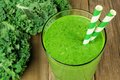 Green kale smoothie close up on wood background Royalty Free Stock Photo
