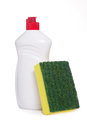 Green kitchen sponge and bottle of dishwashing liquid Royalty Free Stock Image