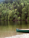 Green lake and canoe Royalty Free Stock Photo