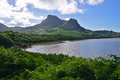 Green landscape with coastal mangroves water and Lion Mountain nearby Mahebourg, Mauritius Royalty Free Stock Photo