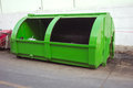 green large metal recycling dumpster, Rusty old dumpster behind