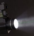 Green laser and light that are mounted on a handgun Royalty Free Stock Images