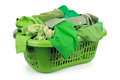 Green laundry clothes in a basket on white background concept for environmental conservation and eco friendly washing Stock Photo