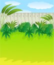 Green lawn and wooden fence Royalty Free Stock Photography