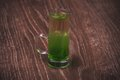 Green layered alcohol shot cocktail