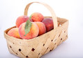 Green leaf on peach in basket a of fresh peaches a white background Royalty Free Stock Photos