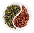 Green leaf tea versus coffee beans in Yin Yang Royalty Free Stock Photo