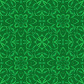 Green leaves seamless pattern made of lines and Royalty Free Stock Photo