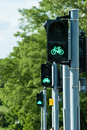 Green light for bicycles three traffic lights in a row Royalty Free Stock Photos