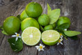 Green lime lemon on wood Royalty Free Stock Photo