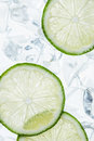 Green lime slices and ice cube Royalty Free Stock Photo