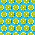 Green lime slices pattern on vibrant turquoise background