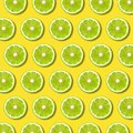 Green lime slices pattern on vibrant yellow color background