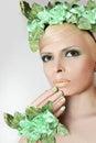 Green makeup and nail Polish. Royalty Free Stock Photo