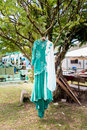 Green malay wedding dress hanging on tree Stock Photography