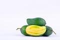 Green  mango peeled and three fresh  green mangoes on white background healthy fruit food isolated Royalty Free Stock Photo
