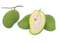 Green mangos and a half inside isolated Stock Photography