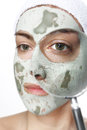 Green mask and magnifying glass beautiful woman with enlarged eye Royalty Free Stock Images