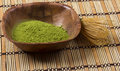Green matcha in a bowl with wisk Royalty Free Stock Photography