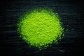 Green matcha tea powder on black background Royalty Free Stock Photo