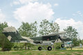 Green military airplane parking with nature Stock Photo
